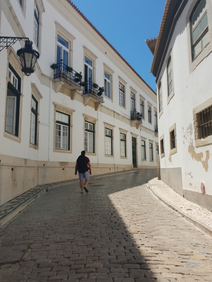 Faro, Portugal,  walking streets, white buildings, 4 freckled faces