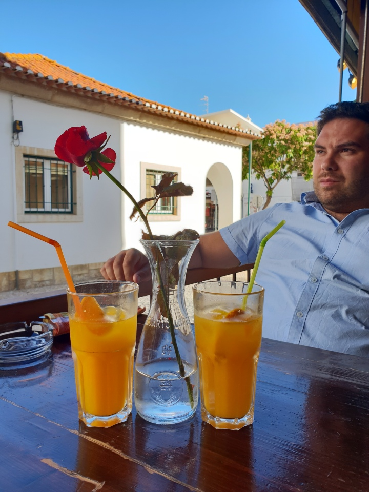 Breakfast in Portugal, albufeira, Algarve, handsome man, orange juice, red flower