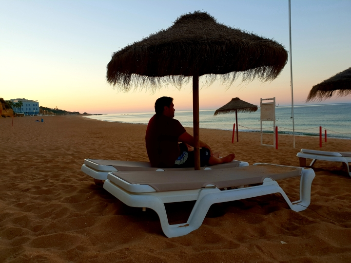 Sunrise, sunrise on the beach, Portugal, Algarve, pretty, beautiful, man sitting and relaxing