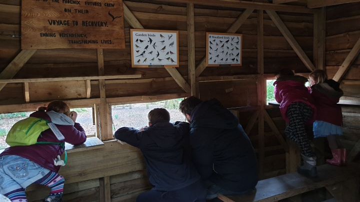 Looking for birds in a bird hide. 4 Freckled Faces.