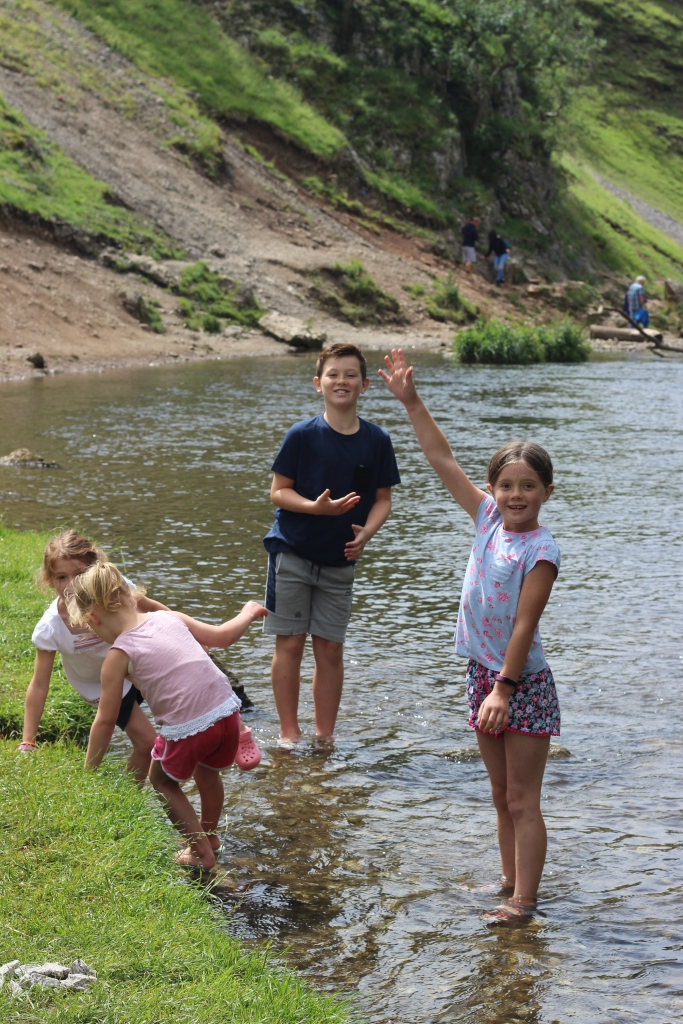 Dovedale. River. Children playing in a river. England. 4 Freckled Faces